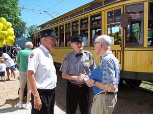 Bruce Kobs (left) and Excelsior Streetcar Line Superintendent, Bob Johnson (center) chat with a visitor.