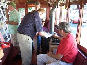 Shown signing a copy of the book is John Diers while the other author, Aaron Isaacs waits his turn.